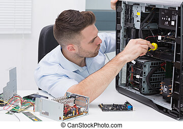 Hardware professional examining cpu with stethoscope at...
