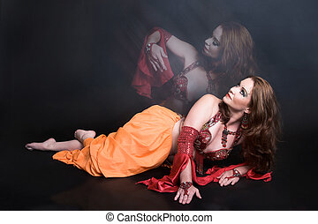 Belly Dancer in Red - Belly Dancer wearing a red costume...
