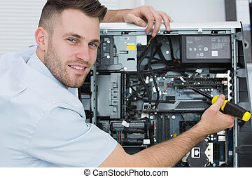 Portrait of computer engineer working on cpu - Portrait of...