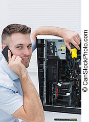 Portrait of computer engineer working on cpu while on call