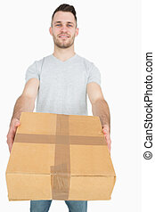 Portrait of young man giving you a package box over white...