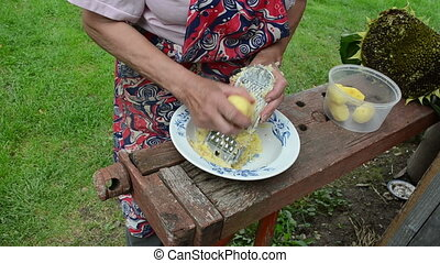 old woman grater potato - senior woman hands shredder potato...