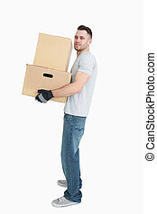 Portrait of young man carrying package boxes