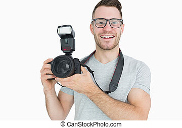 Portrait of photographer with photographic camera over white...