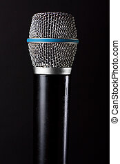 Classic microphone isolated on black