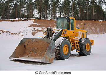 Wheel Loader at Winter Sand Pit - Yellow wheel loader at...