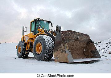 Wheel Loader at Winter Sand Pit - Yellow wheel loader at...