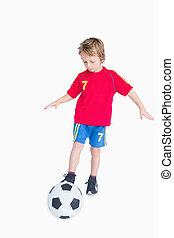 Little boy playing football over white background