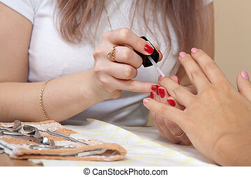 manicurist working with nails - manicurist working with...