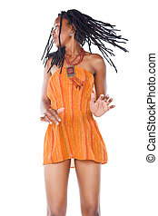 Rastafarian girl - Rasta woman with orange dress dancing...