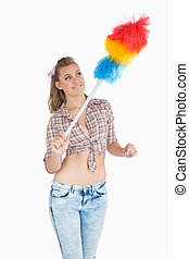 Casual woman using colorful feather duster
