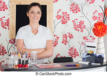 Confident woman at reception in nail salon - Portrait of...