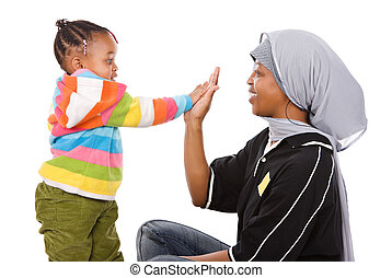 Muslim family - Muslim mother high five with her cute little...