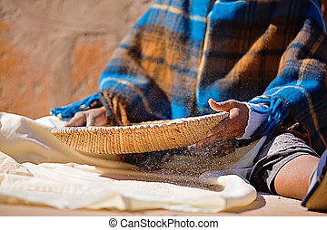 Poverty - Portrait of African woman with a basket sieve...