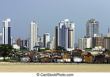 Modern buildings and palafitte slum - Modern buildings and...