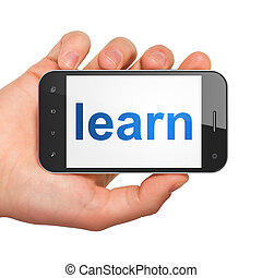 Hand holding smartphone with word learn on display. Generic...