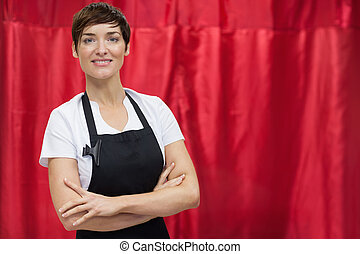 Portrait of a hairdresser with arms crossed