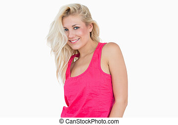 Portrait of happy casual young woman with blonde hair over...