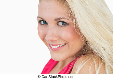 Close-up portrait of beautiful young woman with blue eyes and blonde hair over white background