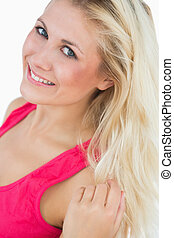 Portrait of beautiful woman with blue eyes and blonde hair -...