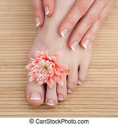 French nail treatment at spa center - Close-up of french...