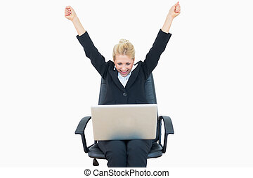Successful business woman raising hands in victory with...
