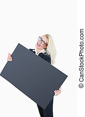 Portrait of cheerful business woman holding empty banner...