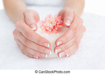 French manicured fingers and flower - Close-up of french...