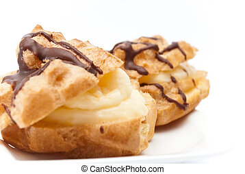Chocolate and creamy eclairs