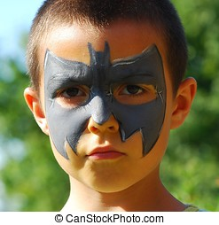 bat child - close-up of child painted in the face as a bat