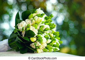 Wedding Bouquet - Wedding bouquet of freesias on a natural...