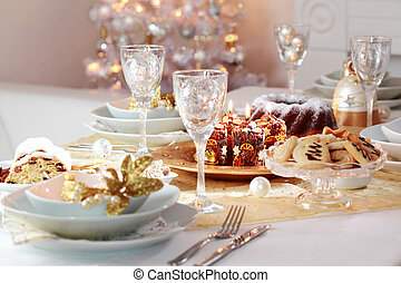 Decorated Christmas table with tree in background