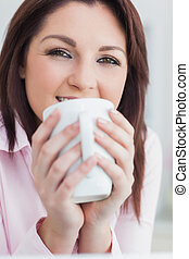 Close-up of woman with coffee cup