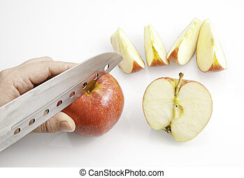 Cutting an apple with steel knife, kitchen and preparation