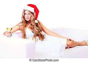 indulge - Beautiful blonde woman in festive white dress and...