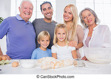 Family posing in the kitchen