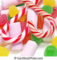 christmass candies - closeup of a pile of candy canes,...