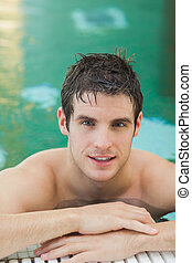 Handsome man in the pool - Handsome man smiling in the pool