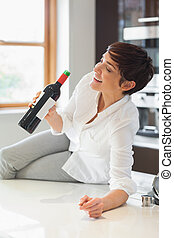 Woman drinking wine from the bottle