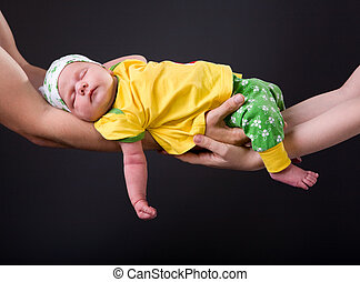 Supporting Hands. Parents holding 14 days old baby girl on...