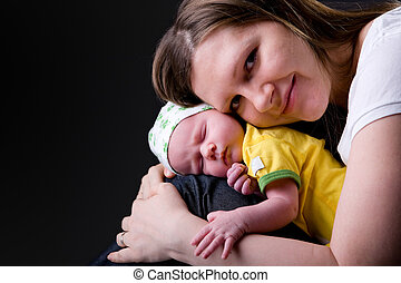 Happy mother and newborn - Studio picture of happy young...