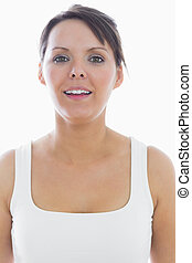 Close-up portrait of an attractive young woman in tank top