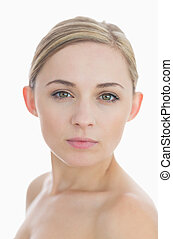 Close-up portrait of fresh womans face over white background...
