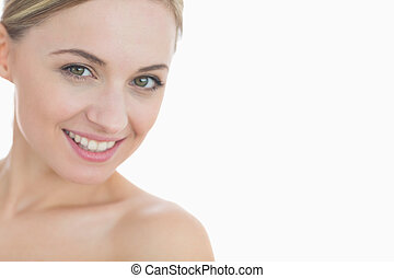 Close-up portrait of beautiful young woman over white...