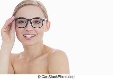 Close-up portrait of attractive young woman wearing glasses...
