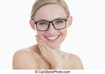 Close-up portrait of happy young woman wearing glasses over...
