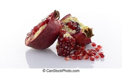Broken half pomegranate fruit on wh
