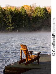 An adirondack chair on a dock.
