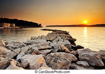 Sunset in Pylos, Greece - Image of a sunset in the town of...