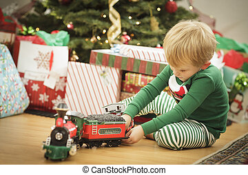 Young Boy Enjoying Christmas Morning Near The Tree - Cute...